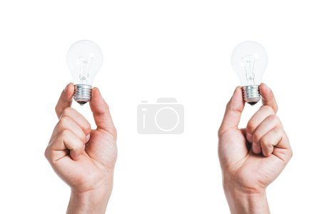 Photo for Cropped view of led lamps in male hands isolated on white, energy efficiency concept - Royalty Free Image