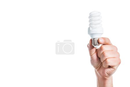 cropped view of fluorescent lamp in male hand isolated on white, energy efficiency concept