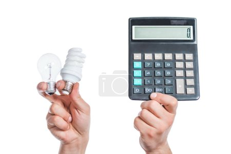 cropped view of male hands holding led and fluorescent lamps next to calculator in hands isolated on white, energy efficiency concept