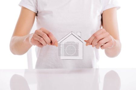 partial view of woman holding paper house isolated on white, mortgage concept