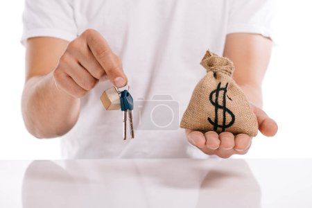 cropped view of man holding keys and moneybag isolated on white, mortgage concept