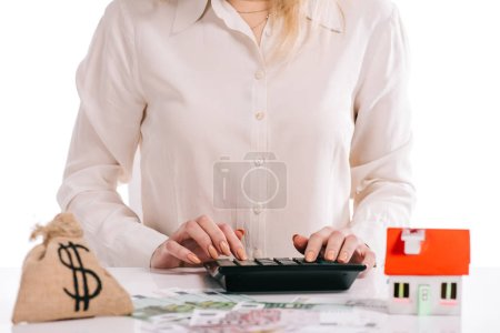 cropped view of businesswoman using calculator isolated on white, mortgage concept