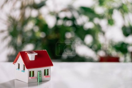 Photo for Selective focus of house model on white desk, mortgage concept - Royalty Free Image