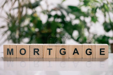 Photo for Selective focus wooden cubes with letters on white desk, mortgage concept - Royalty Free Image