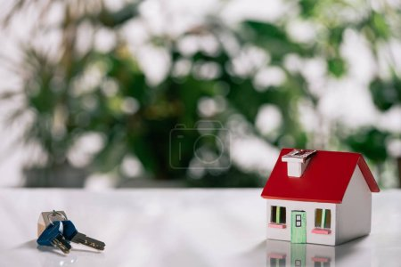 Photo for Selective focus of keys and house model on white desk, mortgage concept - Royalty Free Image