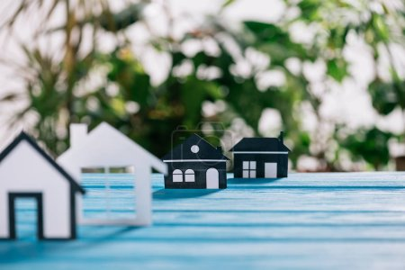 Photo for Selective focus of paper houses on blue wooden desk, mortgage concept - Royalty Free Image