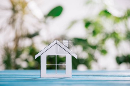 Photo for Selective focus of paper house on blue wooden desk, mortgage concept - Royalty Free Image
