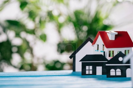 Photo for Selective focus of paper houses and house model on wooden desk, mortgage concept - Royalty Free Image