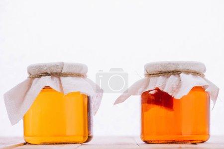 bottled organic kombucha mushroom with tea in jars isolated on white