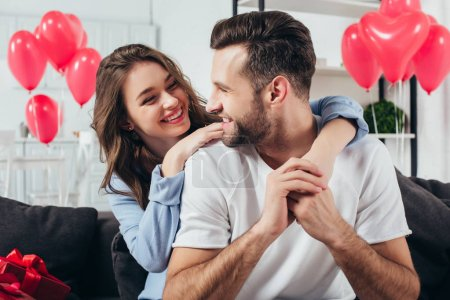 loving young couple celebrating st valentine day at home