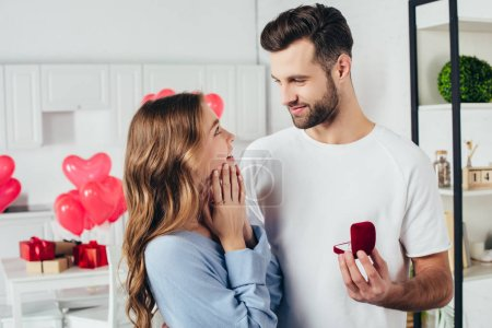 selective focus of man doing proposal at valentines day to girlfriend