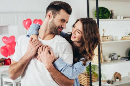 Photo for Selective focus of happy girl embracing boyfriend at st valentines day - Royalty Free Image