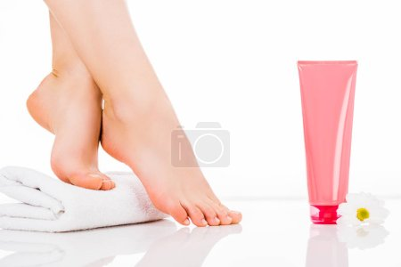 Photo for Partial view of beautiful female legs on towel isolated on white - Royalty Free Image