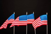 background of american flags isolated on black