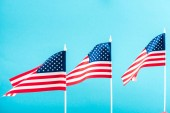 background of american flags isolated on blue