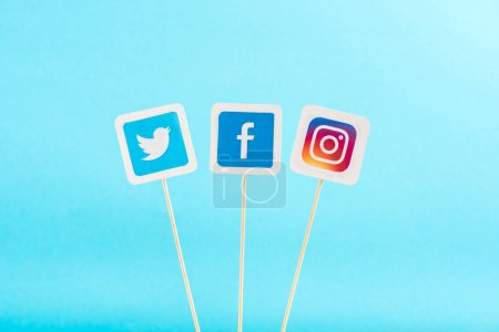 Photo for Top view of twitter, facebook and instagram icons isolated on blue - Royalty Free Image