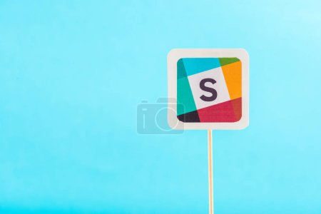 top view of slack icon isolated on blue with copy space