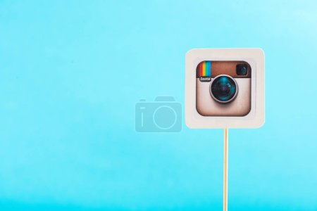 Photo for Top view of instagram icon isolated on blue with copy space - Royalty Free Image
