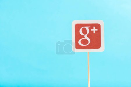 top view of google plus icon isolated on blue with copy space