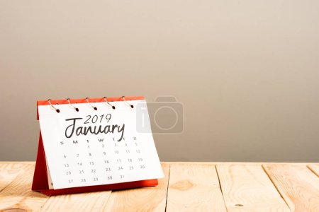 calendar with 'january 2019' lettering isolated on beige with copy space