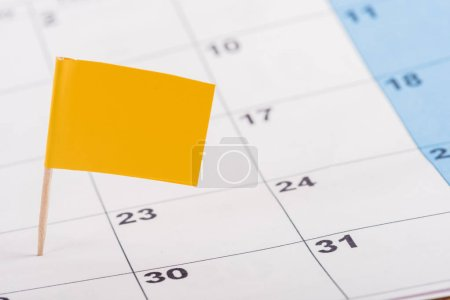 Photo for Selective focus of yellow flag on number 22 in calendar - Royalty Free Image