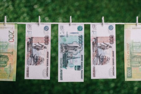 rubles banknotes hanging with clothespins on clothesline, money laundering concept