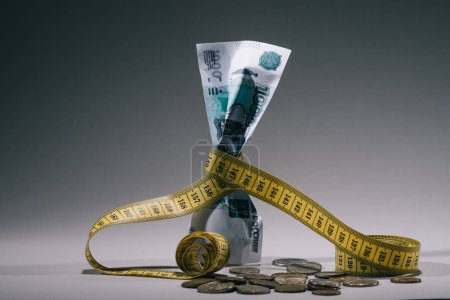 Photo for Close-up view of russian rubles banknote with measuring tape on grey, financial crisis concept - Royalty Free Image
