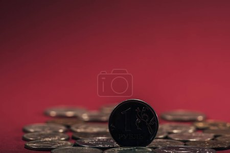 close-up view of russian rubles coins on red background, selective focus