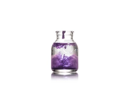 Photo for Studio shot of glass jar with water and purple splash isolated on white - Royalty Free Image