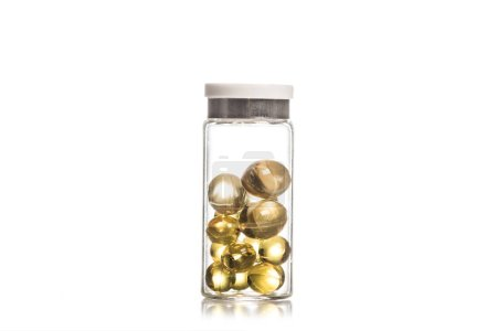 Photo for Studio shot of fish oil pills in glass container isolated on white - Royalty Free Image