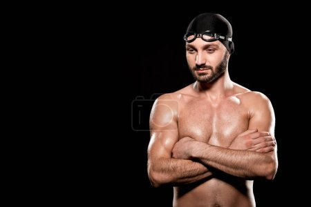 Photo for Handsome swimmer standing with crossed arms isolated on black - Royalty Free Image