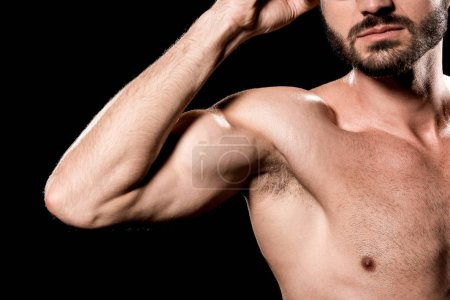 Photo for Cropped view of strong sportsman showing muscles isolated on black - Royalty Free Image