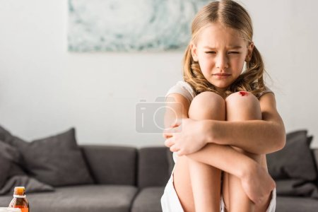Photo for Upset kid with wound crying at home - Royalty Free Image