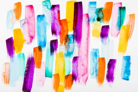 Photo for Top view of pink, purple, yellow, blue and orange brushstrokes on white background - Royalty Free Image
