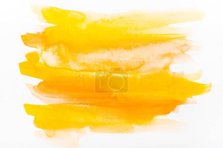 Photo for Top view of yellow watercolor brushstrokes on white paper - Royalty Free Image