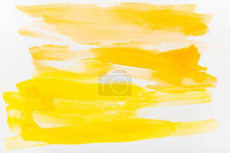 Photo for Top view of yellow watercolor brushstrokes on white background - Royalty Free Image