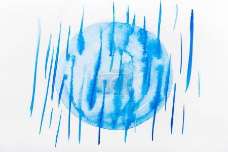 Photo pour Vue de dessus du cercle et bleu de coups de pinceau et le déversement sur le livre blanc - image libre de droit