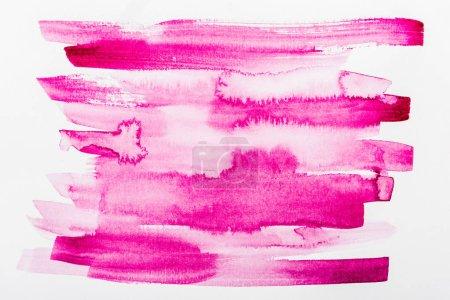 Photo pour Vue de dessus des coups de pinceau roses sur papier blanc - image libre de droit
