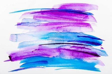 Photo pour Vue de dessus des coups de pinceau bleu et violet sur fond blanc - image libre de droit