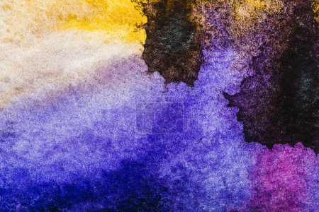 Photo for Top view of yellow, black, blue and purple watercolor spills with copy space - Royalty Free Image