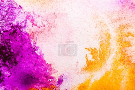 top view of yellow and pink watercolor spills on white background with copy space