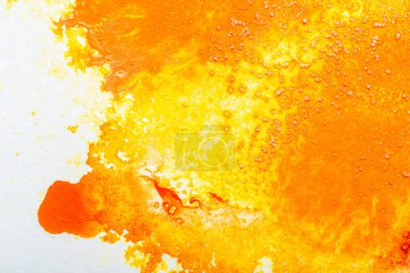 Photo for Top view of yellow and orange watercolor spills on white paper with copy space - Royalty Free Image