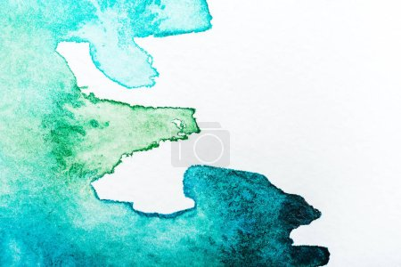 top view of turquoise watercolor spill on white background