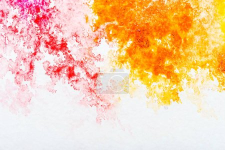 Photo for Top view of red and orange watercolor spills on white background - Royalty Free Image