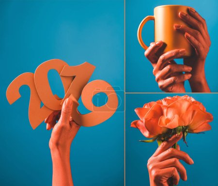 Photo for Partial view of coral colored female hands with paper cut 2019 numbers on blue background, color of 2019 concept - Royalty Free Image
