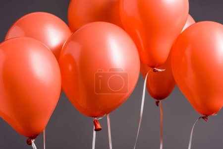 Photo for Bright coral air balloons on grey background, color of 2019 concept - Royalty Free Image