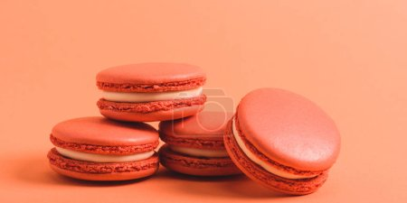 Photo for Tasty coral macarons on purple background, color of 2019 concept - Royalty Free Image