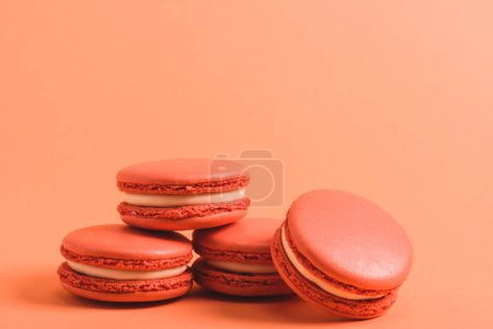 Photo for Delicious coral macarons on purple background, color of 2019 concept - Royalty Free Image
