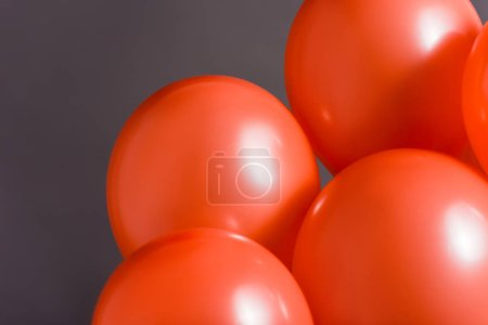 Photo for Coral air balloons on grey background, color of 2019 concept - Royalty Free Image