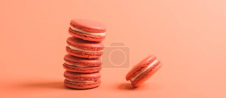 Photo for Delicious macarons on coral background, color of 2019 concept - Royalty Free Image